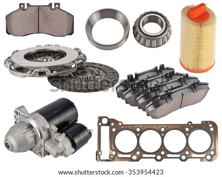 A new set of auto spare parts on white  - stock photo