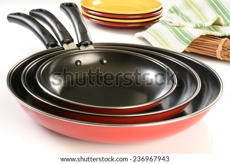 A new set of non stick frying pans with ceramic coating - stock photo