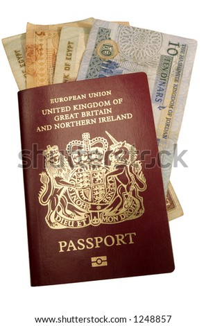 """A new-style biometric British passport, showing the """"chip"""" logo on its front cover, with some jordanian and Egyptian currency notes - stock photo"""