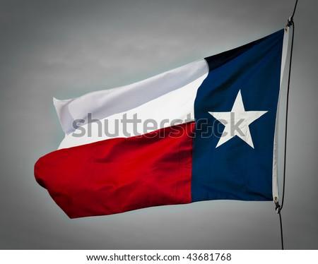 A new Texas flag flapping in the wind. - stock photo