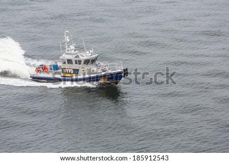 A New York City Police Boat Speeding Across the Harbor - stock photo