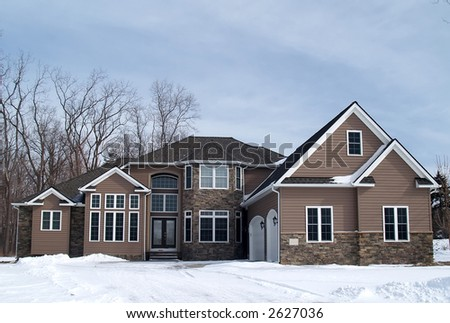 A newly constructed large home in a suburban development - stock photo
