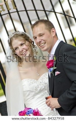 A newly wed Bride and Groom sharing a few moments together after their wedding - stock photo