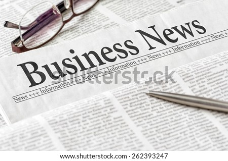 A newspaper with the headline Business News - stock photo