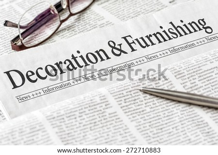 A newspaper with the headline Decoration and Furnishing - stock photo
