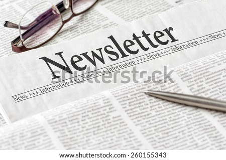 A newspaper with the headline Newsletter - stock photo