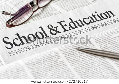 A newspaper with the headline School and Education - stock photo