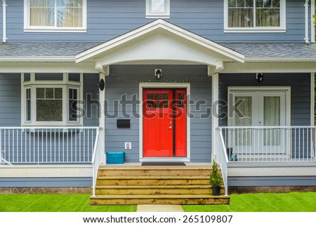 A nice entrance of a luxury house over outdoor landscape - stock photo