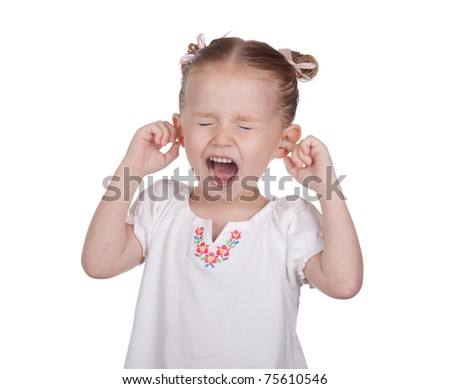 A nice image of a young girl with her ears blocked and yelling. - stock photo