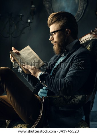 A nice man in glasses with a book - stock photo