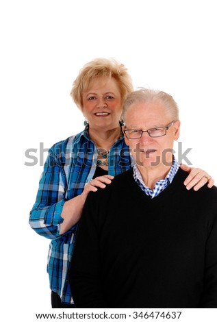 A nice mature couple standing isolated for white background, thewife behind the man. - stock photo
