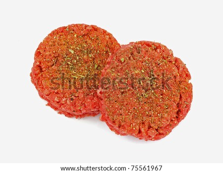 A nice overhead view of two well seasoned patties. - stock photo