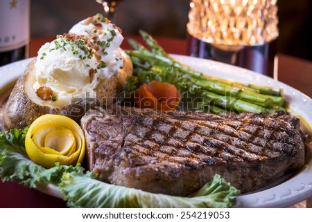 A nice steak, baked potato and grilled asparagus makes for a good meal July 18, 2014 in Omaha Nebraska. - stock photo