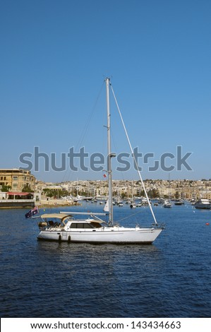 a nice yacht resting in a sea harbour - stock photo