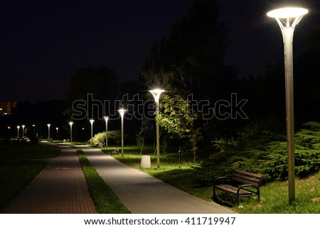 A Night in the Park. Late Wood Benches ,Alley  - stock photo