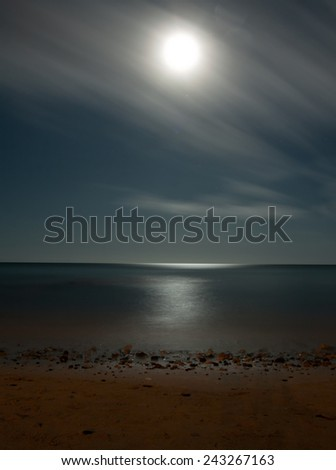 A night photo of moon, beach and ocean. Fuerteventura Spain  - stock photo