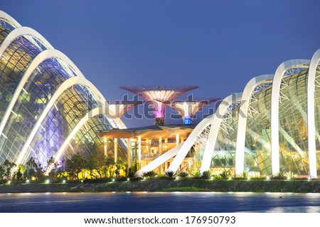 A night view of The Supertree Grove, Cloud Forest & Flower Dome at Gardens by the Bay on Feb 15, 2014 in Singapore. Spanning 101 hectares, five-minute walk from Bayfront MRT Station. - stock photo