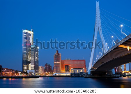 A night view on Erasmus bridge and Nieuwe Maas river in Rotterdam, Netherlands. GPS information is in the file - stock photo