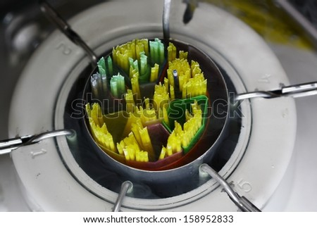 A Nitrogen bank with straws of bull semen with Nitrogen vapor. - stock photo