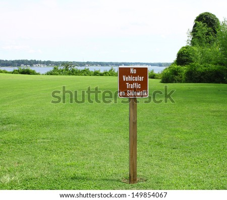 A no vehicular traffic sign in the grass field overlooking the york river and Gloucester point Virginia on a sunny summer day - stock photo