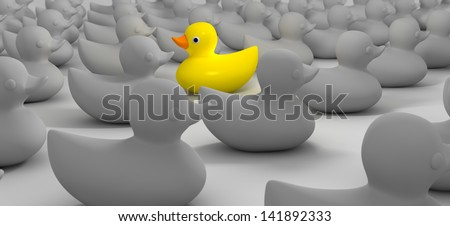 A non-conformist depiction of a yellow rubber bath duck swimming against the flow of a sea of grey rubber ducks - stock photo