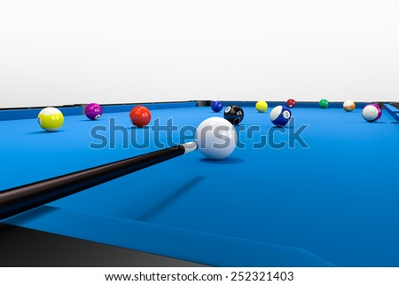 A non visible Player is aiming over his pool queue to put a ball into the billard pocket. The Pool table stands on a floor with a clean wall in the background. - stock photo