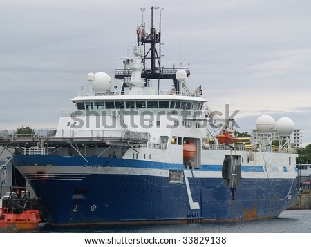 A Norwegian seismic research vessel lies at Ogdon Point wharf off of Victoria BC.  Length: 105 m  Gross Tonnage: 9811 Launched: 1993 as a trawler and refit to current application 2007 - stock photo