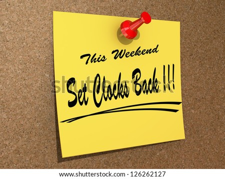 A note pinned to a cork board with the text This Weekend Set Clocks Back. - stock photo
