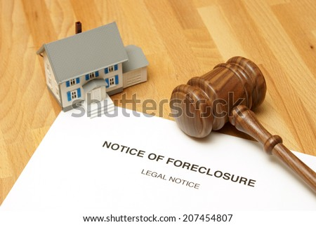 A notice of foreclosure to this unlucky home owner. - stock photo