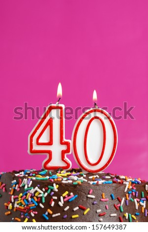 A number candle is lit in celebration of forty years. - stock photo