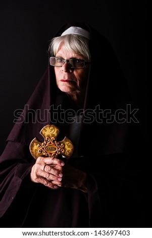 A nun holding a cross - stock photo