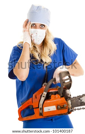 A nurse is holding a chain saw and she has blood on her. - stock photo