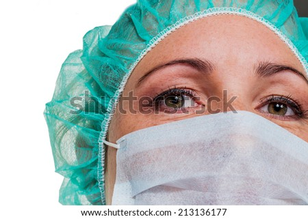 a nurse or doctor in surgical clothes before surgery. symbol photo for stress and overtime at the hospital. - stock photo