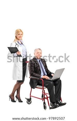 A nurse pushing a busy businessman working on a laptop in a wheelchair isolated on white background - stock photo