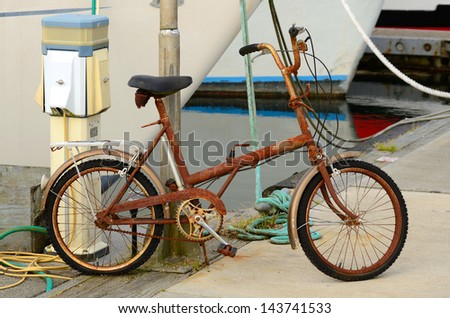 A old rusted bike sitting at dock in Charleston Oregon on the Pacific Ocean near Coos Bay - stock photo
