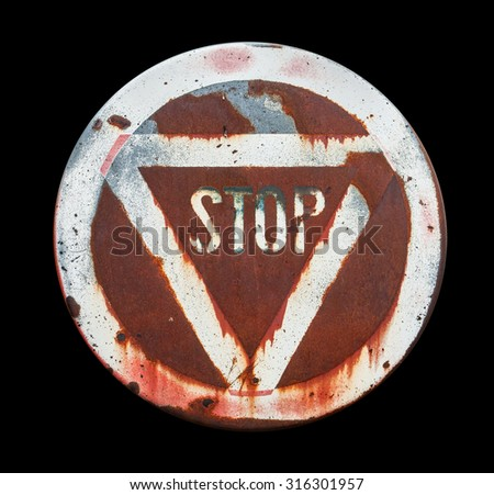 a old weathered stop sign in black back - stock photo