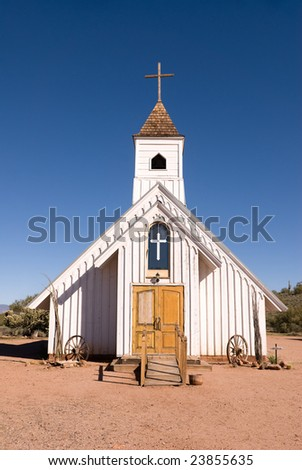 A one hundred year old wooden church in the open desert - stock photo