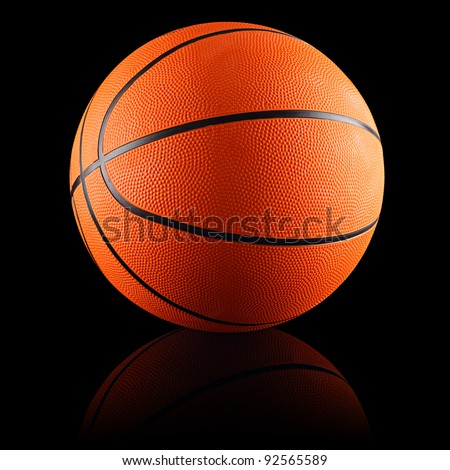 a orange basketball in front of black background - stock photo