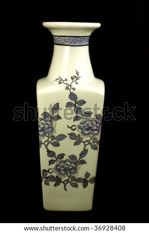 a oriental vase decorated with painted flowers - stock photo