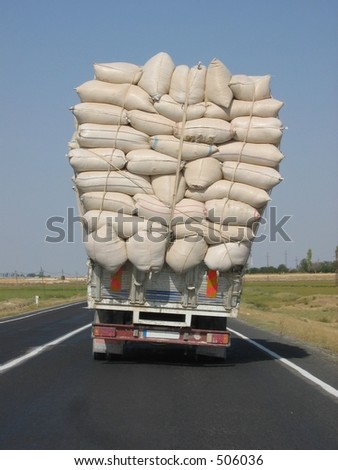 A overloaded truck - stock photo