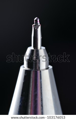 A Overused Red Roller-Ball Pen Tip Close-Up Shot Using Macro Lens. - stock photo