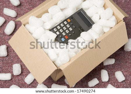 A Package Containing A Calculator - stock photo