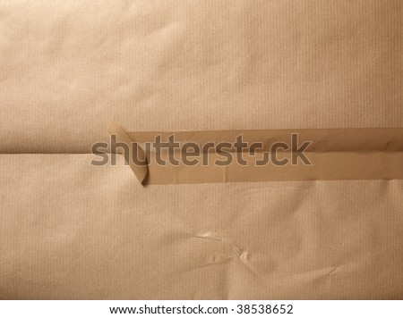 A packet  with a open tape. - stock photo