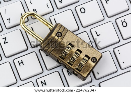 a padlock on a computer keyboard. symbol photo for data security and hacking - stock photo