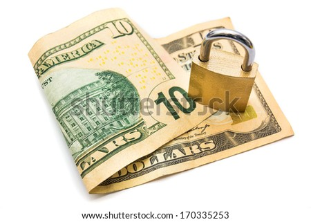 A padlock on top of a 10 dollar note isolated on white background - stock photo