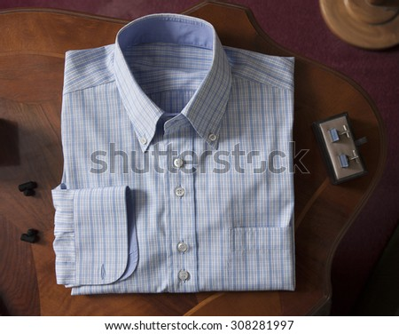 a paid shirt fold in plan with cufflinks - stock photo