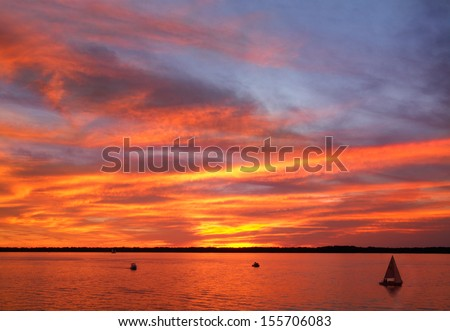 A Paintbrush Sunset Sky Over Presque Isle Bay As Seen From Dobbins Landing During The Perry 200 Commemoration, September 2013, Erie Pennsylvania, USA - stock photo