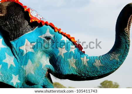 A painted elephant showing off its decorations at the Elephant Festival in Jaipur, India - stock photo
