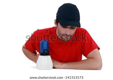 A painter with a spray gun. - stock photo