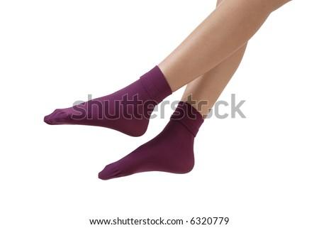a pair feet with purple socks - stock photo